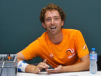 Switserland, Genève, September 16, 2015, Tennis,   Davis Cup, Switserland-Netherlands, Practise Dutch team, good atmosphere in the Dutch team Matwe Middelkoop as DJ making loud music in the tennishal<br /> Photo: Tennisimages/Henk Koster