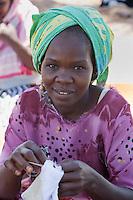 Kizimkazi Dimbani, Zanzibar, Tanzania.  Woman Sewing.