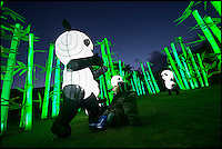 BNPS.co.uk (01202 558833)<br /> Pic: PhilYeomans/BNPS<br /> <br /> Jamie Swanson(4) meets an illuminated panda.<br /> <br /> The largest Chinese 'Festival of Light' seen in Europe is taking shape at the Longleat House in Wiltshire - A small army of over 50 skillled workers have flown in from the remote village of Zigong in central China to create the stunning spectacle.<br /> <br /> Among the different scenes are a 20-metre tall Chinese temple, a 70-metre-long dragon, created using more than 10,000 porcelain cups, bowls, plates and dishes, and the mythical qilin &ndash; a chimerical hooved creature with the head of a lion &ndash; featuring more than 30,000 glass phials filled with coloured liquid.<br /> <br /> Massive traditional Chinese masks are also featured and there is also a bamboo forest which is home to a family of life-size pandas, giant elephants, zebras, lions and deer as well as giant lotus flowers floating on the lake.<br /> <br /> Filled with thousands of LED lights and handmade by a team of 50 highly-skilled craftsmen from Zigong in China's Sichuan province, the lanterns recreate a magical world of myths and legends.<br /> <br /> Set amid the beautiful backdrop of the landscaped grounds and gardens surrounding Longleat House, the lit structures also spill out on to Half Mile Lake to create a stunning and enchanting experience for visitors.<br /> <br /> It&rsquo;s the first time a festival of this size has taken place in the UK and the Chinese team behind the spectacular event believe its size and complexity make it unique throughout Europe.