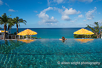 The Caribbean, Anguilla. Woman in the pool at Malliouhana Hotel.