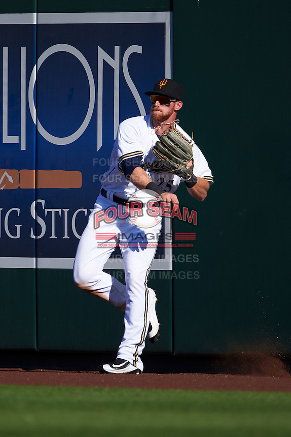 Surprise Saguaros outfielder Michael Reed (25) throws the ball in during an Arizona Fall League game against the Glendale Desert Dogs on October 23, 2015 at Salt River Fields at Talking Stick in Scottsdale, Arizona.  Glendale defeated Surprise 9-6.  (Mike Janes/Four Seam Images)