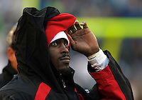 Atlanta QB Michael Vick (7) watches the game from the sidelines after playing in the first half and sitting out the second half due to the Falcons already clinching home field in the playoffs. Atlanta Falcons vs. Seattle Seahawks at Qwest Field in Seattle on Sunday Jan. 2, 2005 Photo by Kevin P. Casey/WireImage.com