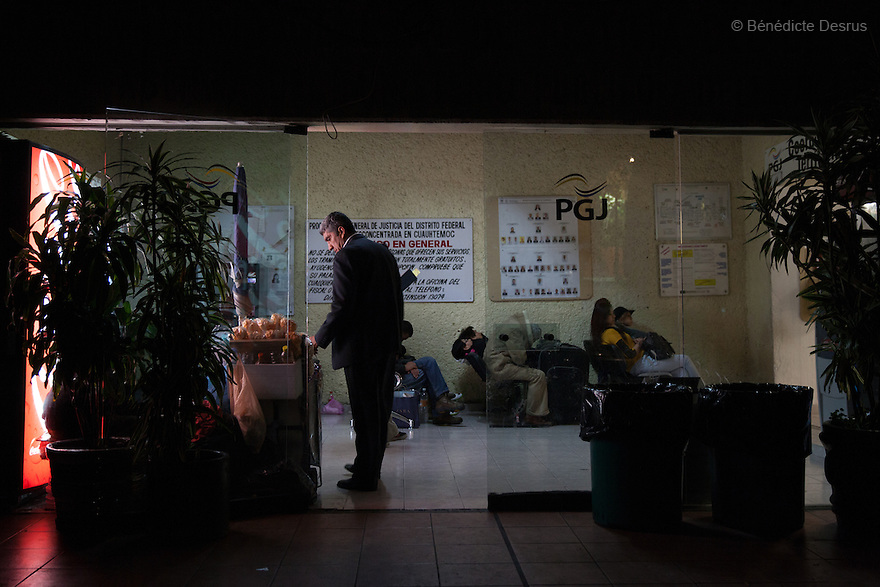 """Donovan leaves his business cards at the Attorney General's Office of Mexico City on May 24, 2015. Donovan Tavera, 43, is the director of """"Limpieza Forense México"""", the country's first and so far the only government-accredited forensic cleaning company. Since 2000, Tavera, a self-taught forensic technician, and his family have offered services to clean up homicides, unattended death, suicides, the homes of compulsive hoarders and houses destroyed by fire or flooding. Despite rising violence that has left 70,000 people dead and 23,000 disappeared since 2006, Mexico has only one certified forensic cleaner. As a consequence, the biological hazards associated with crime scenes are going unchecked all around the country. Photo by Bénédicte Desrus"""