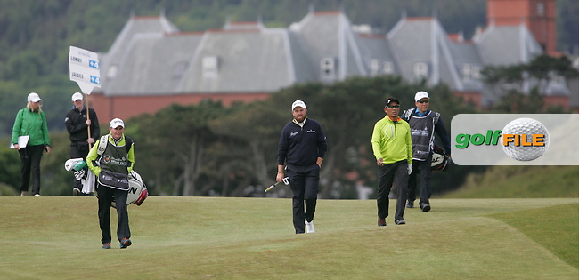 Shane LOWRY (IRL) and Thongchai JAIDEE (THA) walking up the 1st during round 3 of the 2015 Dubai Duty Free Irish Open hosted by the Rory Foundation, Royal County Down Golf Club, Newcastle Co Down, Northern Ireland. 30/05/2015<br /> Picture TJ Caffrey, www.golffile.ie