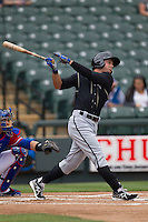 Omaha Storm Chasers outfielder David Lough #7 follows through on his swing against the Round Rock Express in the Pacific Coast League baseball game on April 7, 2013 at the Dell Diamond in Round Rock, Texas. Omaha beat Round Rock 5-2, handing the Express their first loss of the season. (Andrew Woolley/Four Seam Images).
