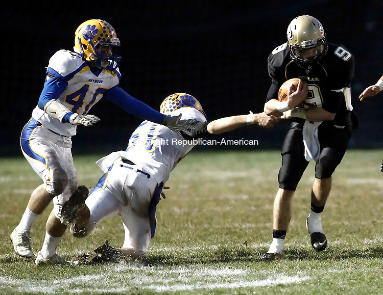 Beacon Falls, CT- 25 November 2014-112514CM20-  Woodland's Mike Kenney (9) carries the ball as Seymour's Christopher Abate (40) and Tyler Sirowich (51) try to make the stop during their matchup in Beacon Falls on Tuesday.  Christopher Massa Republican-American