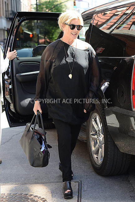 WWW.ACEPIXS.COM<br /> May 11, 2014 New York City<br /> <br /> Deborra-Lee Furness and family out and about on Mother's Day in New York City on May 11, 2014.<br /> <br /> By Line: Kristin Callahan/ACE Pictures<br /> ACE Pictures, Inc.<br /> tel: 646 769 0430<br /> Email: info@acepixs.com<br /> www.acepixs.com