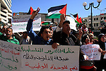 Palestinian demonstrators take part in a protest calling for Palestinian political unity between Gaza's Hamas rulers and the Fatah-dominated Palestinian Authority which rules from Ramallah, on March 15, 2011in Nablus, as Palestinian activists across the Gaza Strip and the West Bank stage a day of massive demonstrations to call for political unity. Photo by Wagdi Eshtayah