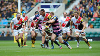 Nathan Hughes of London Wasps is tackled by Matt Kvesic of Gloucester Rugby during the Aviva Premiership match between London Wasps and Gloucester Rugby at Twickenham Stadium on Saturday 19th April 2014 (Photo by Rob Munro)