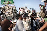 In this Tuesday, Jul. 09, 2013 photo, supporters of the ousted president Mohammed Morsi demostrate in the streets nearby Al-Rabba Alawya mosque a day after the shooting that left 50 dead outside the Republican Guard heardquarters in Cairo, Egypt. (Photo/Narciso Contreras).