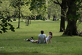Young couple with a dog, Kensington Gardens, London.