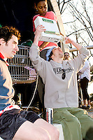 Teams celebrate reaching the finish line of the third annual Idiotarod in New York City on January 28, 2006.  <br /> <br /> The playfully named Idiotarod is a race between teams of five people pulling stylized shopping carts, starting in the borough of Brooklyn and ending in Manhattan.  Teams are given only checkpoints and must devise their own routes to make it to each finish line.  Awards are not only given to the first finishers but also to those with the best costumes, best bribes, and most creative sabotage techniques.  Imbibing of alcohol or other substances is neither required nor discouraged and the race is administered by the mysterious group C.O.B.R.A. (Carts of Brooklyn Racing Association).