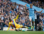 Kevin De Bruyne of Manchester City in action with Jeffrey Schlupp of Crystal Palace during the English Premier League match at the Etihad Stadium, Manchester. Picture date: May 6th 2017. Pic credit should read: Simon Bellis/Sportimage