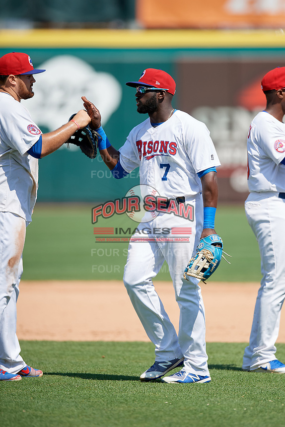 Buffalo Bisons center fielder Anthony Alford (7) high fives with Rowdy Tellez (34) after a game against the Pawtucket Red Sox on June 28, 2018 at Coca-Cola Field in Buffalo, New York.  Buffalo defeated Pawtucket 8-1.  (Mike Janes/Four Seam Images)