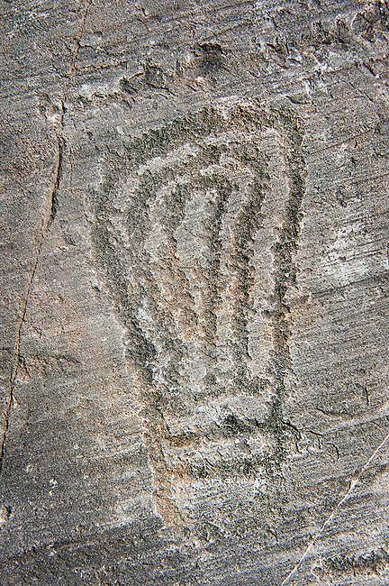 Petroglyph, rock carving, carved by the ancient Camunni people in the iron age between 1000-1200 BC. Foppi di Nadro, Rock no 24, Riserva Naturale Incisioni Rupestri di Ceto, Cimbergo e Paspardo, Capo di Ponti, Valcamonica (Val Camonica), Lombardy plain, Italy
