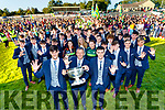 Captain Paul O Shea, Kerry Manager Peter Keane and Keith O Leary lift the Tom Markham cup at the Kerry Minor Football team homecoming at Kilcummin at Kilcummin GAA club on Monday night.