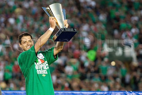 25.06.2011. Pasadena, California, USA - Mexico forward Javier Chicharito Hernandez #14 receives the Golden Boot Award after the 2011 CONCACAF Gold Cup championship game between United States and Mexico at a sold out Rose Bowl. Mexico defeated United States with a final score of 4-2