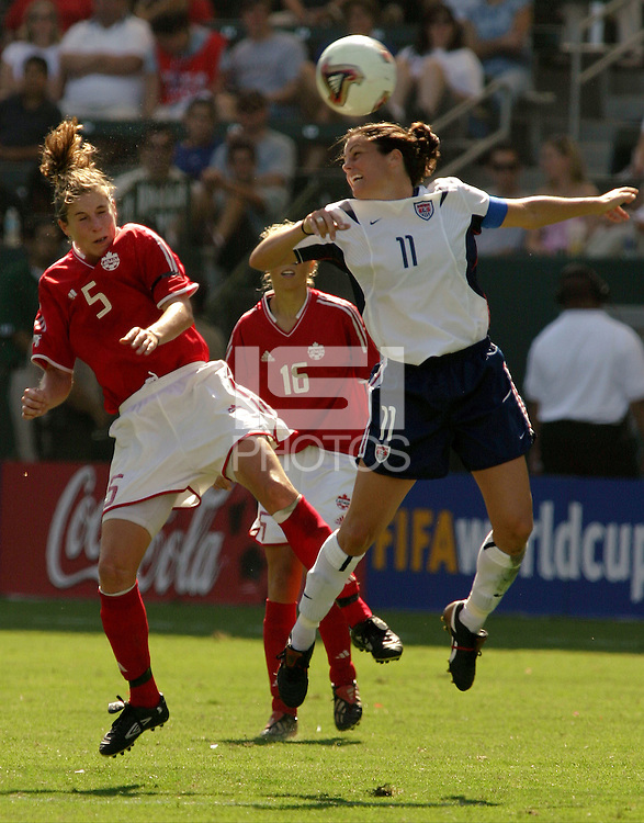Andrea Neil, left, Julie Foudy, right, USA vs. Canada at the Third Place Match of the FIFA Women's World Cup USA 2003. USA 3, Canada, 1. (October 11, 2003). .