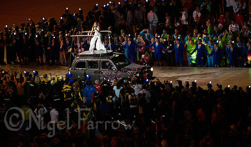 "12 AUG 2012 - LONDON, GBR - Spice Girl Melanie Chisholm performs from the top of a London taxi during the ""A Symphony of British Music"" section at the London 2012 Olympic Games Closing Ceremony in the Olympic Stadium in the Olympic Park, Stratford, London, Great Britain (PHOTO (C) 2012 NIGEL FARROW)"