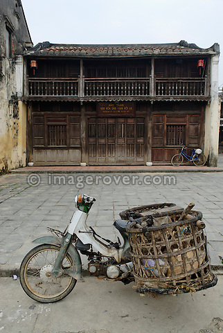 Asia, Vietnam, Hoi An. Hoi An old quarter. Motorbike in front of the Museum of Folklore. The historic buildings, attractive tube houses, and decorated community halls have 1999 earned Hoi An's old quarter the status of a UNESCO World Heritage Site. To protect the old quarter's character stringent conversation laws prohibit alterations to buildings, as well as the presence of cars on the roads.