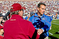 November 27, 2010:   Florida State Seminoles head coach Jimbo Fisher )l) shakes hands with Florida Gators head coach Urban Meyer prior to the start of first half game action between the ACC Conference Florida State Seminoles and the SEC Conference University of Florida Gators at Doak Campbell Stadium in Tallahassee, Florida.