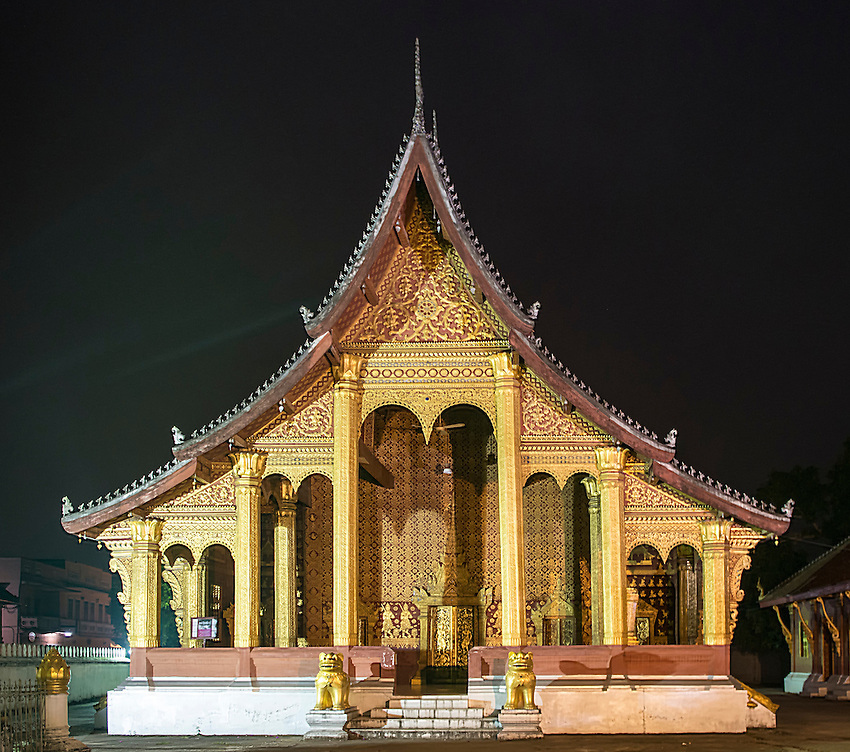 A shot of the illuminated main building of Wat Sensoukharam, Luang Prabang, taken in early morning before sunrise.