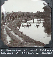 BNPS.co.uk (01202 558833)<br /> Pic: Tooveys/BNPS<br /> <br /> 'A squadron of Kings Dragoons crossing a stream in France'<br /> <br /> Incredibly rare 'action' shots from the Great War come to light...<br /> <br /> The harrowing photos, taken in the middle of an Allied offensive, show soldiers charging into action and bodies strewn on the battlefield.<br /> <br /> The dramatic photos were taken during fierce fighting with the Germans on the Western Front in late 1914.<br /> <br /> The images appear to show a more fluid and fast moving stage of the conflict before both sides became bogged down in the relentless trench warfare of later years.<br /> <br /> One captures the 'Leicester's suprising the Hun' showing the regiment in full flight as they launch a surprise attack on their German adversaries.