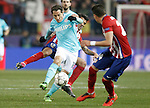 Atletico de Madrid's Augusto Fernandez (b) and Jose Maria Gimenez (r) and PSV Eindhoven's Andres Guardado during UEFA Champions League match. March 15,2016. (ALTERPHOTOS/Acero)