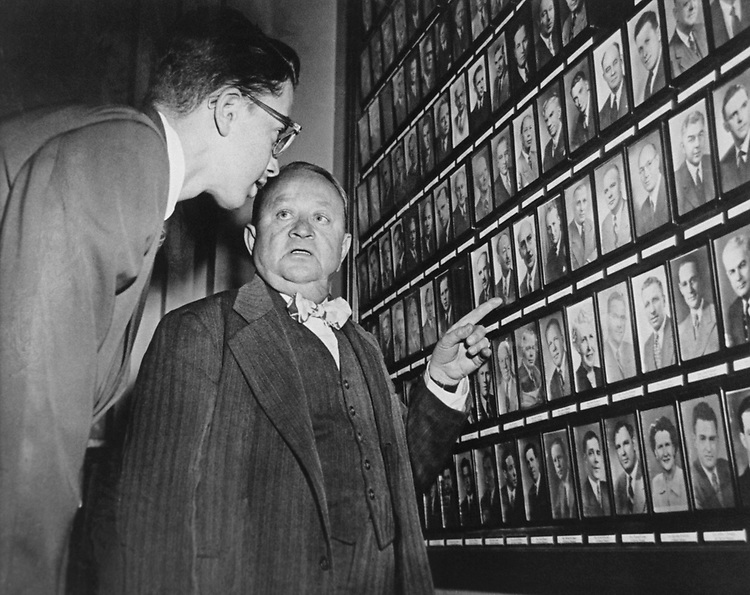 Young page assisted by Chief Page  studies photos of 435 men and women of The House of Representatives.  The Capitol pages are required to recognized instantly all members of Congress, on June 28, 1953. (Photo by CQ Roll Call via Getty Images)
