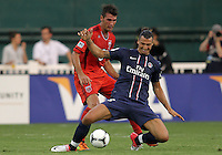WASHINGTON, DC - July 28, 2012:  Emilliano Dudar (19) of DC United pushes into Zlatan Ibrahimovic (18) of PSG (Paris Saint-Germain) in an international friendly match at RFK Stadium in Washington DC on July 28. The game ended in a 1-1 tie.