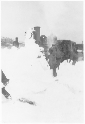 Engine with wedge snowplow being shoveled out in the snow on Cumbres Pass.<br /> D&amp;RG  Cumbres Pass, CO