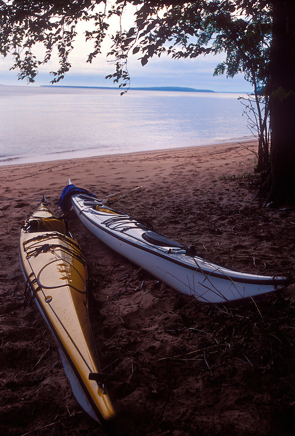 A pair of sea kayaks on the beach of York Island in Apostle Islands National Lakeshore near Bayfield, Wis.