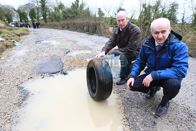 Eddie Downey and Tom Brady Members of the IFA from the Moynalty and Kingscourt area of County Meath showing what they have to endure on the main road from Kells to Kingscourt..Picture: Fran Caffrey/www.newsfile.ie.NO REPO FEE when used with associated press release from the IFA..Contact Niall Madigan..