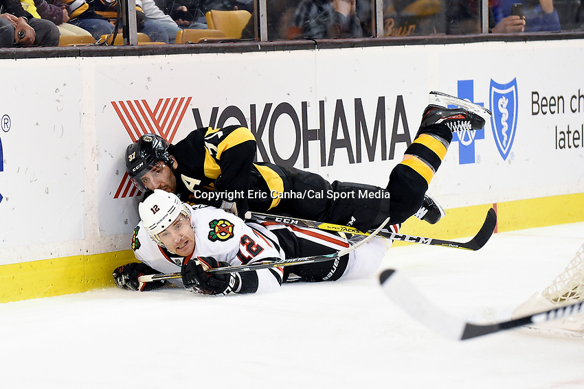 Thursday, March 3, 2016: Boston Bruins center Patrice Bergeron (37) lands on Chicago Blackhawks left wing Tomas Fleischmann (12) during the National Hockey League game between the Chicago Blackhawks and the Boston Bruins, held at TD Garden, in Boston, Massachusetts. Boston defeated Chicago 4-2. Eric Canha/CSM