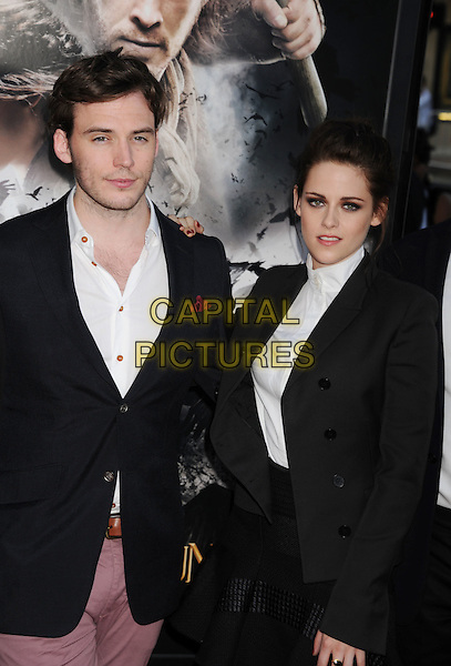 "Sam Claflin, Kristen Stewart.The Los Angeles Screening of ""Snow White And The Huntsman"" at Westwood Village Theatre in Westwood, California, USA..May 29th, 2012 .half length black white blazer shirt blouse skirt jacket pink purple jeans denim.CAP/ROT/TM.©Tony Michaels/Roth Stock/Capital Pictures"