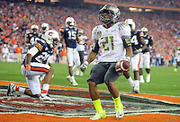 Jan 10, 2011; Glendale, AZ, USA; Oregon Ducks running back LaMichael James (21) celebrates after scoring a touchdown during the second quarter of the 2011 BCS National Championship game against the Auburn Tigers at University of Phoenix Stadium.  Mandatory Credit: Mark J. Rebilas-