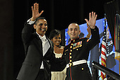 Washington, DC - January 20, 2009 -- United States President Barack Obama, left, and United States Marine Sergeant Elidio Guillen, right, wave to the crowd at the Commander in Chief's Ball in downtown Washington, D.C., on Tuesday, January 20, 2009.  More than 5,000 men and women in uniform are providing military ceremonial support to the presidential inauguration, a tradition dating back to George Washington's 1789 inauguration.  .Credit: Kathrine McDowell - DoD via CNP.