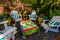 Appetizers and rose wine arranged on a backyard table on a summer evening at a home in Seattle, Washington USA.
