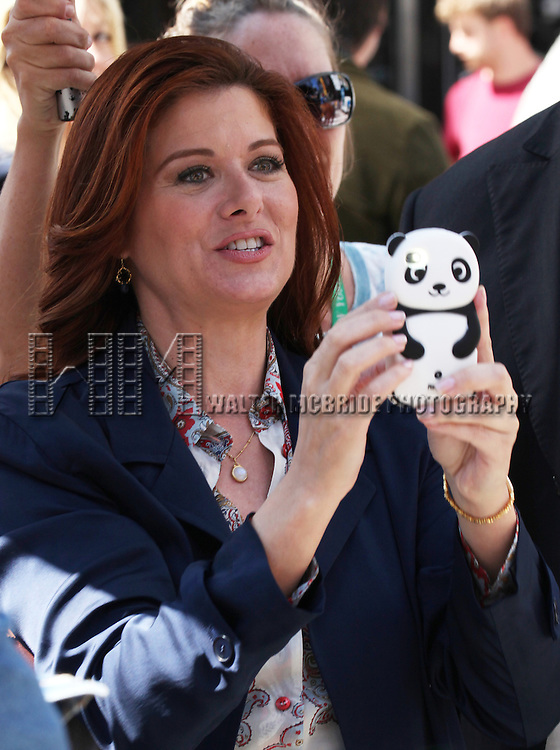 Debra Messing photographing 'Naked Cowboy' while filming a scene from the NBC TV Show 'Smash' in Times Square, New York City on September 12, 2012