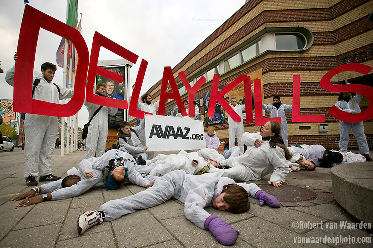 Activists and members of the Avaaz Action Factory draw attention to fact that any delay on a comprehensive agreement on climate change at the upcoming COP 15 in Denmark kills the lives of people across the globe. Copenhagen, Denmark (credit: Robert vanWaarden)