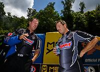 Jun 17, 2017; Bristol, TN, USA; NHRA pro stock driver Jason Line (left) talks with teammate Greg Anderson during qualifying for the Thunder Valley Nationals at Bristol Dragway. Mandatory Credit: Mark J. Rebilas-USA TODAY Sports