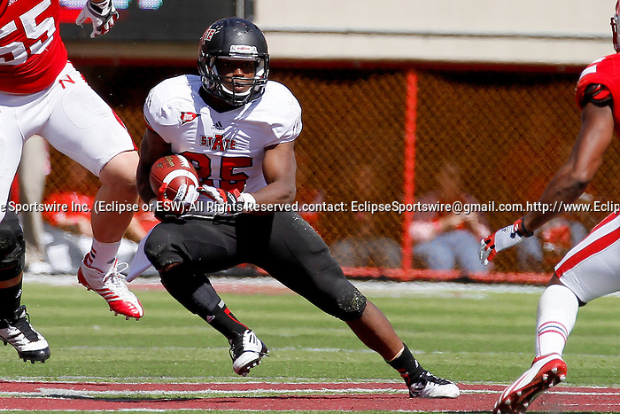 Arkansas State RB #25 David Oku making a move on the Nebraska defense on 9-15-12.