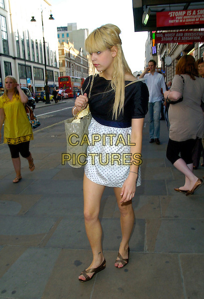 PEACHES GELDOF.Spotted walking along the Strand past the Adelphi Theatre towards Waterloo Bridge, London, England..July 17th, 2007.full length white black top dress polka dot beige bag purse quilted sandals tattoo.CAP/CAN.©Can Nguyen/Capital Pictures