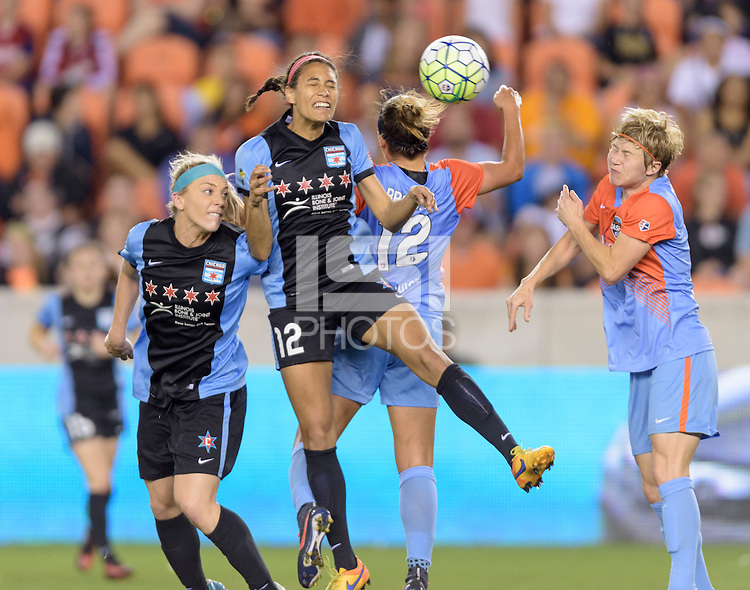 Houston Texas - Cara Walls (12) of the Chicago Red Stars wins a header in the second half over the Houston Dash Amber Brooks (12) on Saturday, April 16, 2016 at BBVA Compass Stadium in Houston Texas.  The Houston Dash defeated the Chicago Red Stars 3-1.