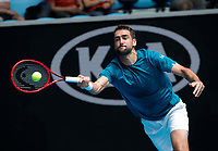 26th January 2020; Melbourne Park, Melbourne, Victoria, Australia; Australian Open Tennis, Day 7; Mario Cilic of Croatia returns during a match against Milos  Raonic of Canada