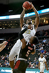 SIOUX FALLS, SD - MARCH 8: Emmanuel Nzekwesi #23 of the Oral Roberts Golden Eagles goes up for a layup against KJ Robinson #5 of the Nebraska-Omaha Mavericks at the 2020 Summit League Basketball Championship in Sioux Falls, SD. (Photo by Dave Eggen/Inertia)