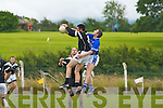 John Dowling of Ardfert takes the ball over Laune Ranger's Johnny Lynch in the division 1 clash at Ardfert on Sunday.   Copyright Kerry's Eye 2008