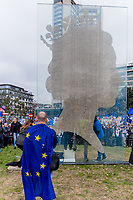 London, UK - March 23 2019: the big queen Elizabeth silhouette and a people with EU flag in the demonstration the people Brexit march for people's vote protest. Photo Adamo Di Loreto/BuenaVista*photo