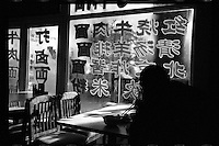 A Chinese man eats a bowl of noodles at a traditional Beijing noodle restaurant in Beijing, China in February 2011. (Leica M6, 35mm f2, Kodak Tri-X film)