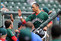 Second baseman Mookie Betts (7) of the Greenville Drive is congratulated in the dugout after scoring a runin a game against the Hickory Crawdads on Sunday, June 9, 2013, at Fluor Field at the West End in Greenville, South Carolina. Hickory won, 6-3. (Tom Priddy/Four Seam Images)